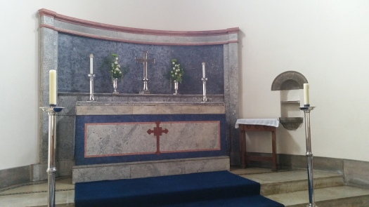 Altar with Reredos behind it and Piscina on the right